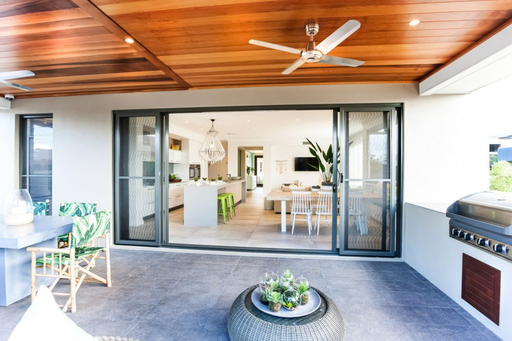 alfresco area of home with fans
