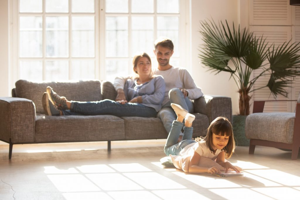 Young family comfortable in home